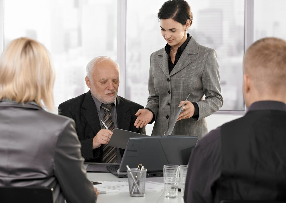 Consulting: Man and Woman in Meeting
