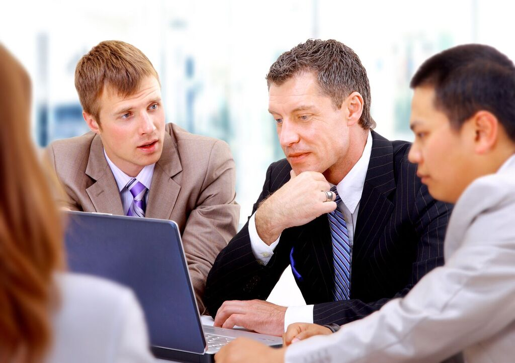 Identify a Strategy: Group of Men at Laptop