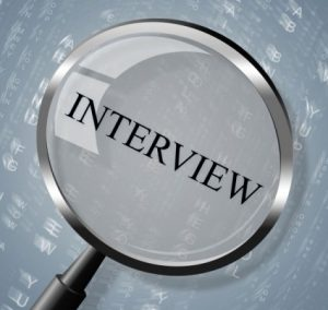 interview-magnifier-shows-research-conference-and-interviewed