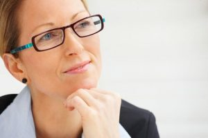 woman with glasses - reflecting