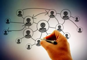 Networking_businessman-hand-drawing-social-network