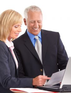 collaborating-business-man-and-woman-working-together