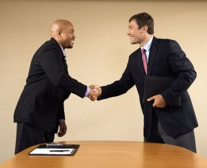 salary-advice-two-business-men-shaking-hands-in-agreement
