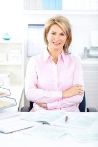 experience-and-education-woman-at-desk-with-books