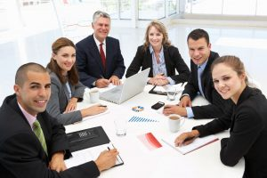 nine-qualities-employers-seek-group-of-professionals-sitting-at-table