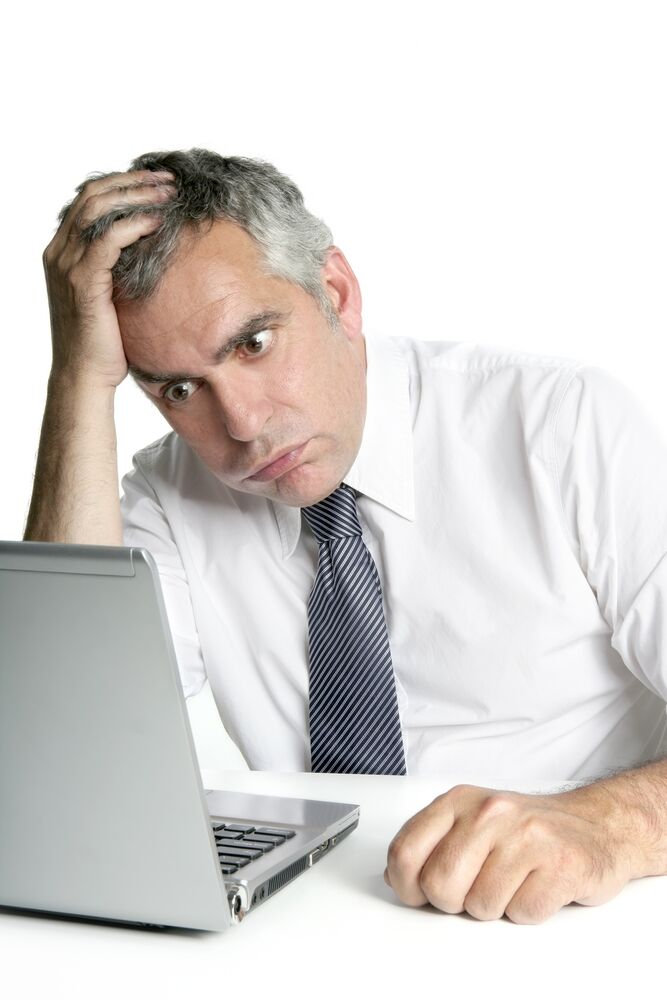 Asking for Help at Work_man confused at laptop