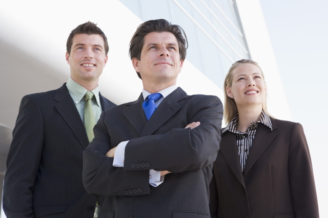 Bringing Your Business Back to Life - 3 professionals standing outside office building