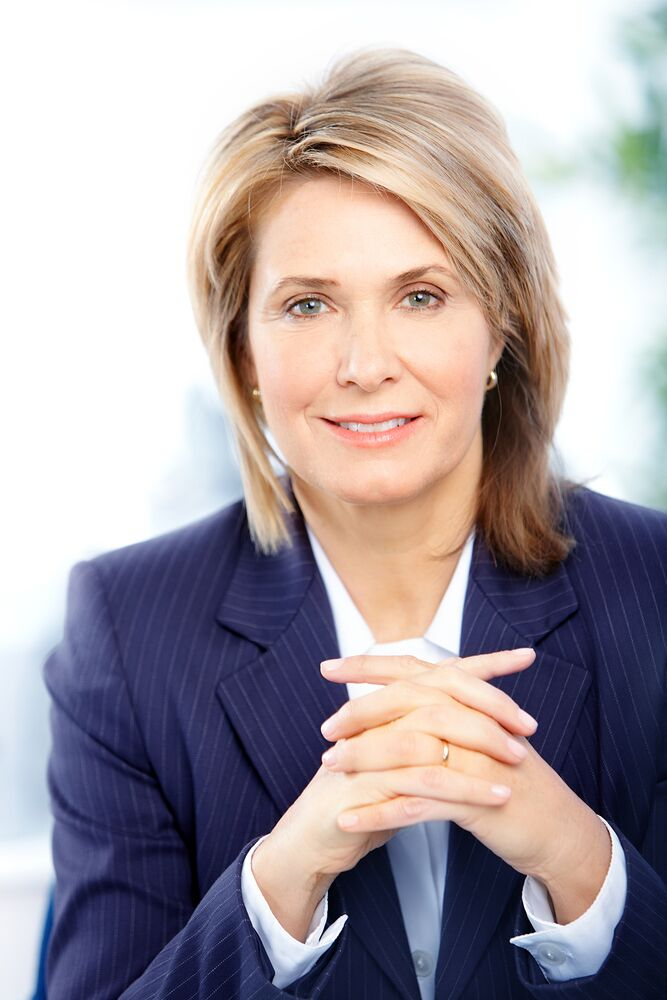 Business Leaders First Impressions - professional woman hands folded