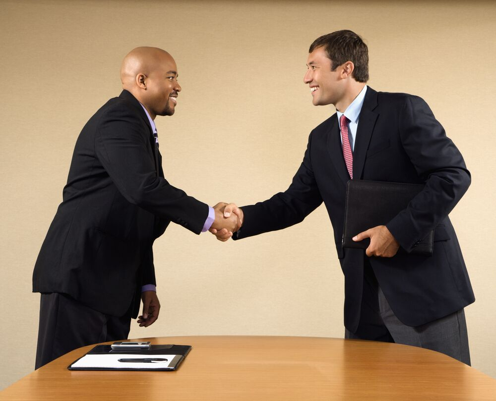 Business Leaders First Impressions - professionals shaking hands