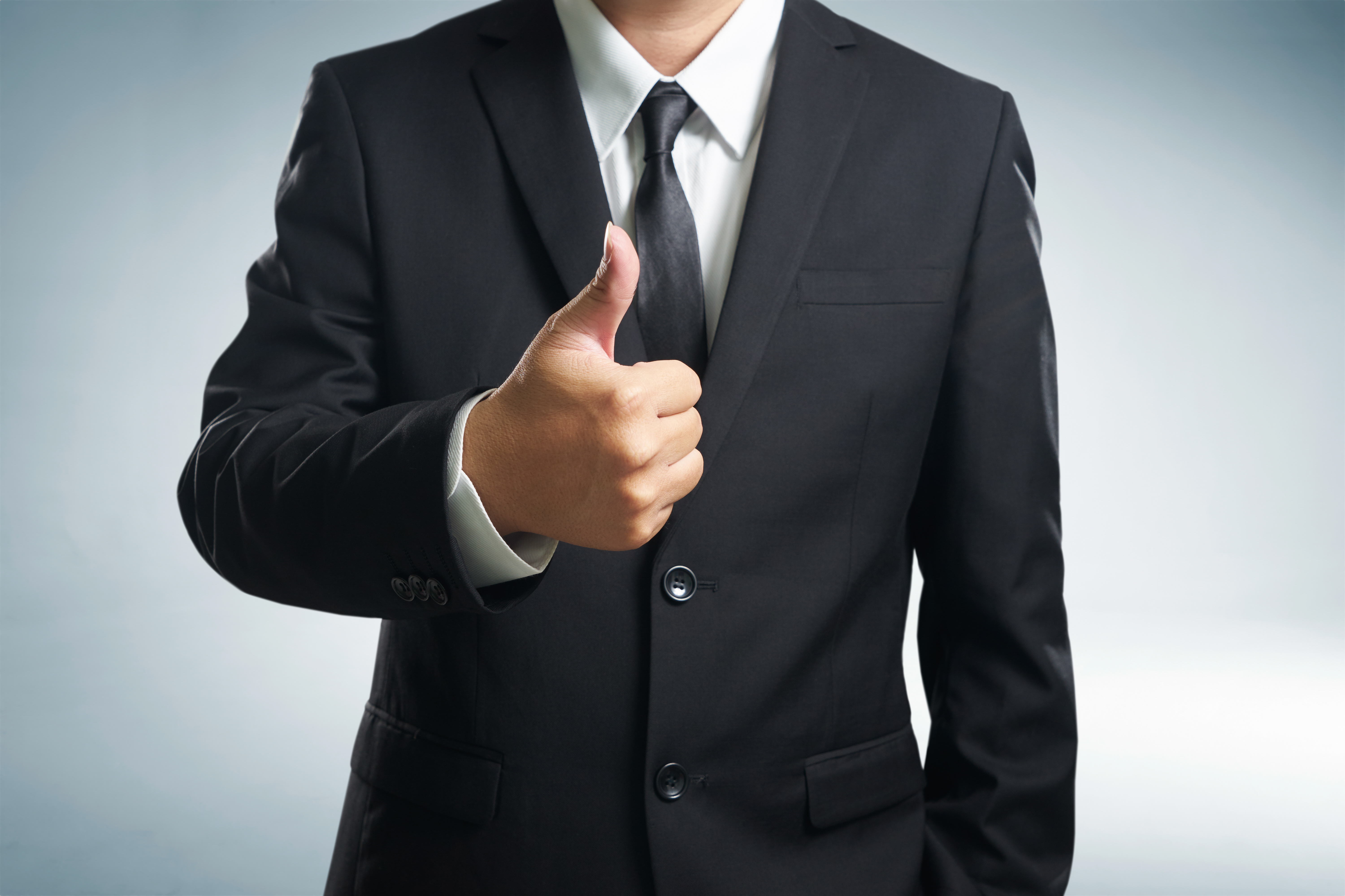 Retained Search Firms - Professional in suite with thumbs-up