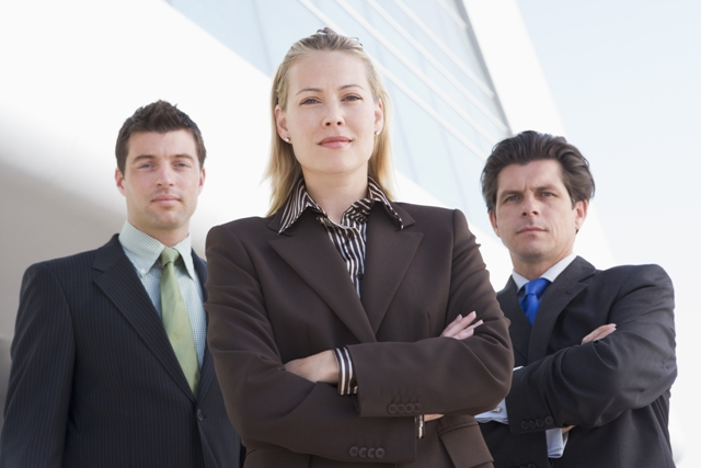 Business Service Industry - 3 professionals standing