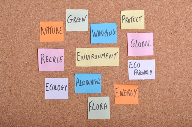 environment concept with keywords written on colorful note papers (bulletin board)