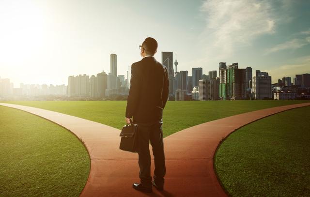 Success_balance - business man approaching 2 paths