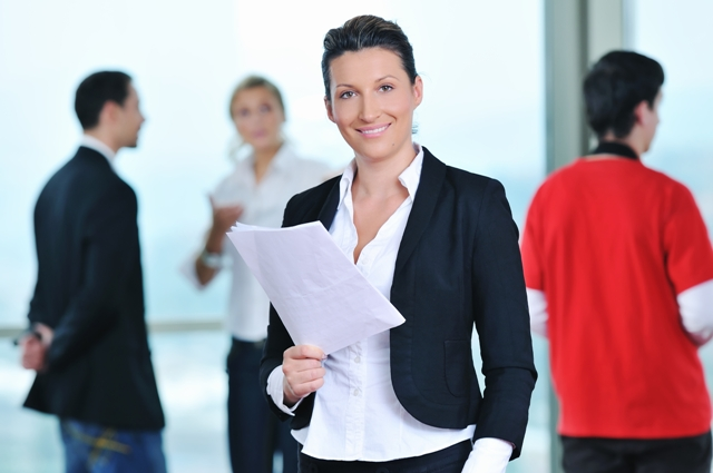Advice from Female Business Leaders - Business Woman with papers - blurred background