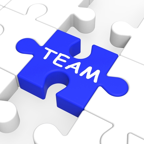 Team Puzzle Shows Team Work And Union