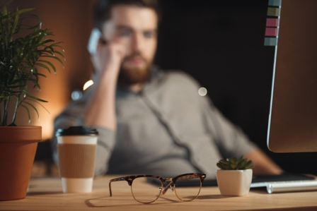 Managing Work Distractions - Professional Man_out of focus_at laptop