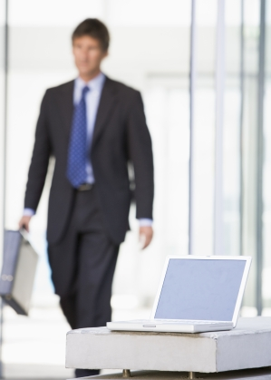 Worst times to quit your job - business man_defocused_with brief case_walking