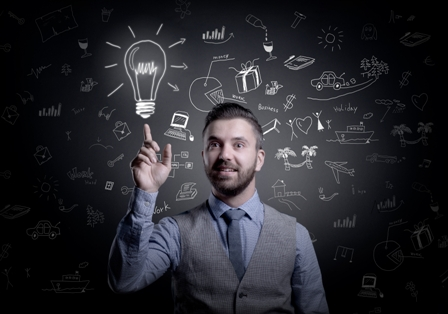 Accelerated-Learning-Professional-Man-with-Lightbulb-in-front-of-Chalkboard