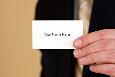 Career Advancement - No Promotion - Businessman holding blank businesscard