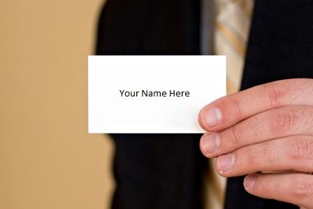 Career Advancement - No Promotion - Businessman holding blank businesscard