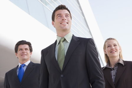 Simples Ways to Stand Out at Work - three business people looking up