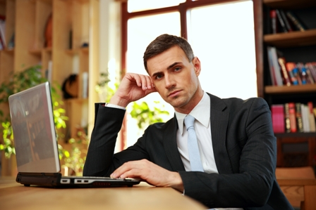 Career-Pitfalls-to-Avoid-Man-at-Laptop-Serious