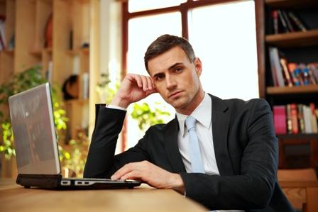 Career-Pitfalls-to-Avoid-Man-at-Laptop-Serious