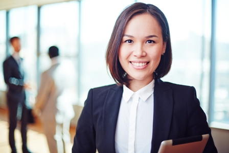 Earning-Respect-as-a-Business-Leader-Professional-Woman-holding-tablet