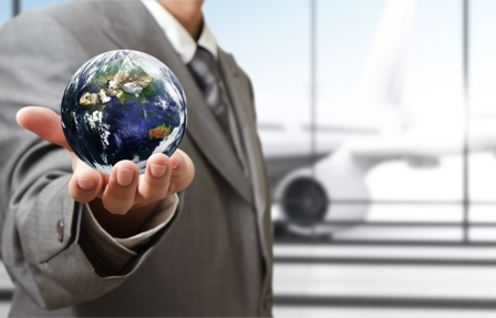Relocating_Tips for Job Seeking - Man in Business Suite Holding Globe