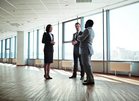 Small-Talk-Skills-group-of-professionals-speaking-in-office-building