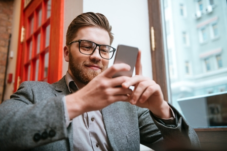Impressing a Recruiter - Man_professional_holding smartphone