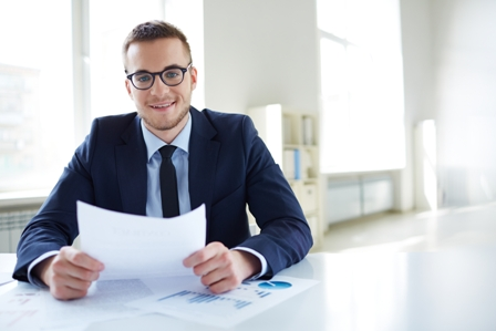 Managing-Different-Types-of-Employees-Business-Man-at-Desk-with-Document