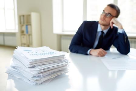 Procrastination-Male-employee_paperwork