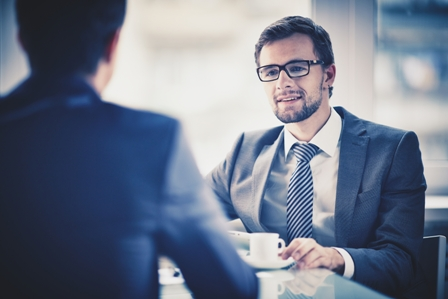 Informational-Interview-Two-professional-men-at-meeting.jpg