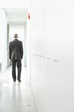 Job-Seeker-Man-in-suit-walking-down-hall.jpg