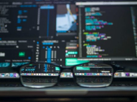 Explaining Tech Jobs - Computer coding screen and glasses