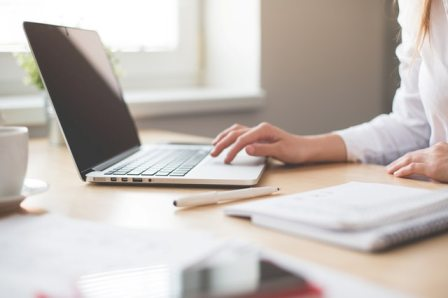 Recruiter Confidence - Professional Woman working on laptop