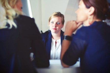 Recruiting actions to avoid - professional woman in meeting