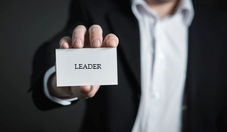 Terms for Leadership - Businessman holding business card