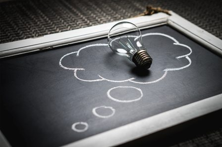 Yearly Business Review Advice - Chalkboard cloud with lightbulb