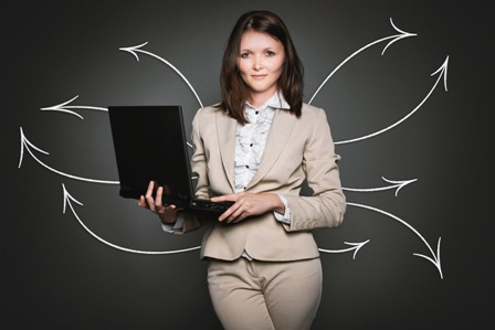 PR Strategies - Businesswoman with laptop_arrows