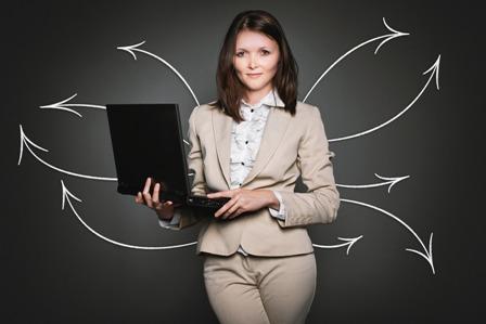 PR Strategies - Businesswoman with laptop_arrows