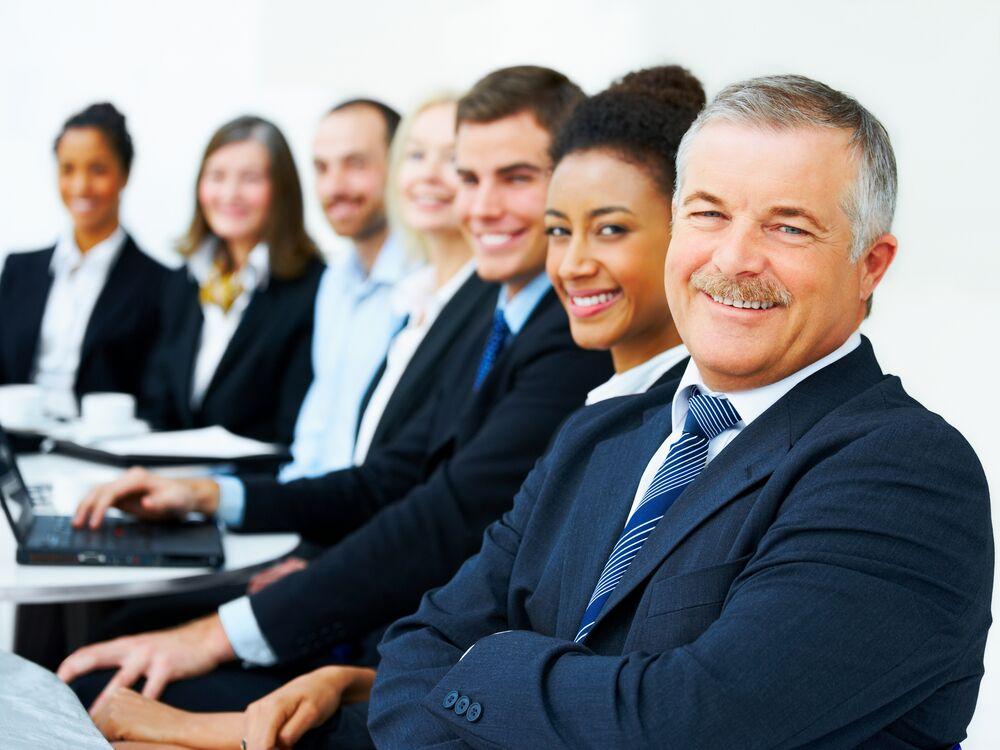 Emotional Intelligence - Group of business employees smiling