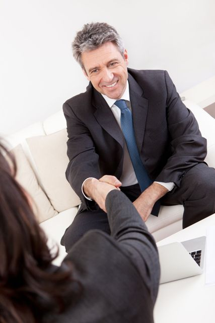 Second Interview Tips - Man shaking hands with professional