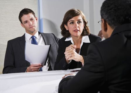 Second Interview Tips - Woman and man speaking to professional