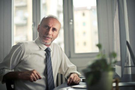 Ageism in the Workplace - Older employee at desk