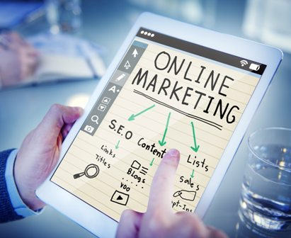 Essential Marketing Tips - Tablet showing online marketing strategies