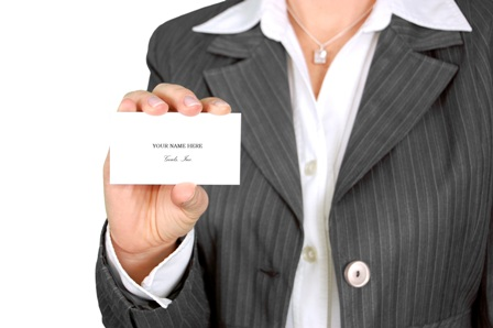 Mindful Career Strategies - Professional Woman Holding Business Card
