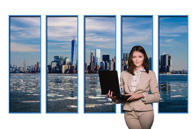 Personal Branding - Professional woman standing with laptop