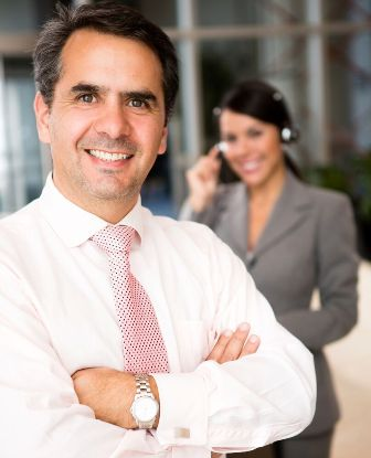 Presenting Topics of Concern to Boss - Professional Man and Woman smiling